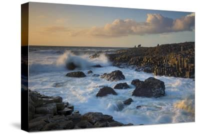 Tourist Watching the Setting Sun on the Giant's Causeway, County Antrim, Northern Ireland-Brian Jannsen-Stretched Canvas Print
