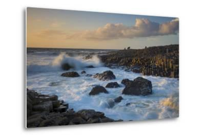 Tourist Watching the Setting Sun on the Giant's Causeway, County Antrim, Northern Ireland-Brian Jannsen-Metal Print