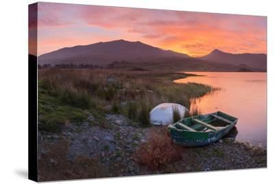 The Sun Rises Behind Mount Snowdon Creating a Beautiful Orange Sky-John Greenwood-Stretched Canvas Print