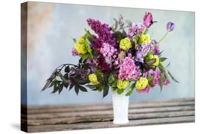 Spring Floral Bouquet with Lilacs, Tulips, Snowball Bush, Hellebore and Euphorbia-Georgianna Lane-Stretched Canvas Print