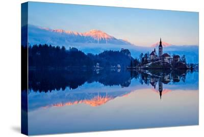 Slovenia, Bled, Lake Bled and Julian Alps, Church of the Assumption-Tuul And Bruno Morandi-Stretched Canvas Print