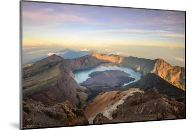 The Mt. Rinjani Crater and a Shadow Cast from the Peak at Sunrise-John Crux-Mounted Photographic Print