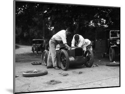Mechanics working on Leon Cushmans Austin 7 racer for a speed record attempt, Brooklands, 1931-Bill Brunell-Mounted Photographic Print