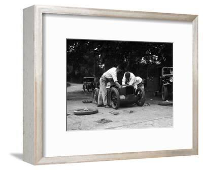Mechanics working on Leon Cushmans Austin 7 racer for a speed record attempt, Brooklands, 1931-Bill Brunell-Framed Photographic Print