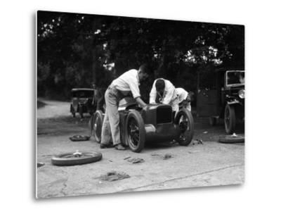 Mechanics working on Leon Cushmans Austin 7 racer for a speed record attempt, Brooklands, 1931-Bill Brunell-Metal Print