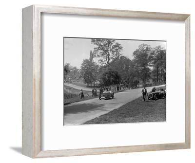 MG J2 passing the crashed Austin 7 of B Sparrow, Donington Park Race Meeting, Leicestershire, 1933-Bill Brunell-Framed Photographic Print