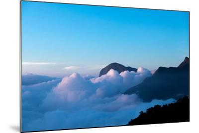 Mountain Peaks Appear Out of Dense Clouds-Prasenjeet Yadav-Mounted Photographic Print