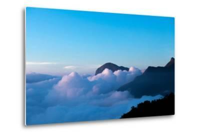 Mountain Peaks Appear Out of Dense Clouds-Prasenjeet Yadav-Metal Print