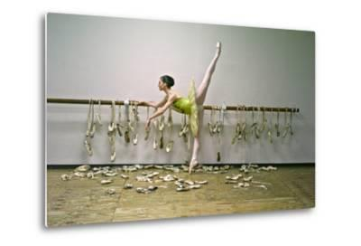 A Ballerina Poses with All the Pointe Shoes She Used in Her Career-Kike Calvo-Metal Print