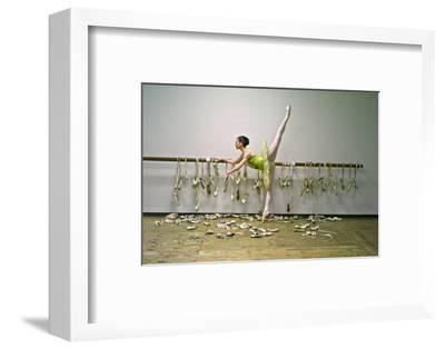 A Ballerina Poses with All the Pointe Shoes She Used in Her Career-Kike Calvo-Framed Photographic Print
