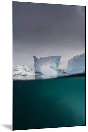 Over-Under View of an Iceberg, Skontorp Cove, Paradise Bay, Antarctica-Sergio Pitamitz-Mounted Photographic Print