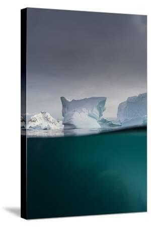 Over-Under View of an Iceberg, Skontorp Cove, Paradise Bay, Antarctica-Sergio Pitamitz-Stretched Canvas Print
