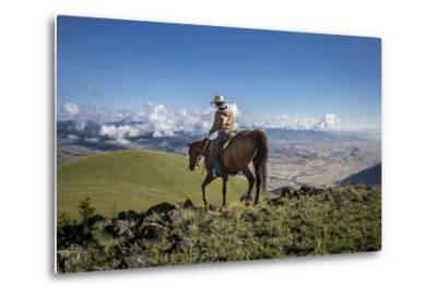 A Woman Rides the Range Above the Anderson Ranch to Deter Predators from the Cattle-Cory Richards-Metal Print
