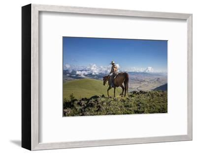 A Woman Rides the Range Above the Anderson Ranch to Deter Predators from the Cattle-Cory Richards-Framed Photographic Print