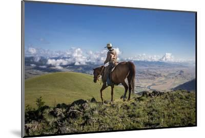 A Woman Rides the Range Above the Anderson Ranch to Deter Predators from the Cattle-Cory Richards-Mounted Photographic Print