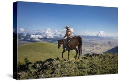 A Woman Rides the Range Above the Anderson Ranch to Deter Predators from the Cattle-Cory Richards-Stretched Canvas Print