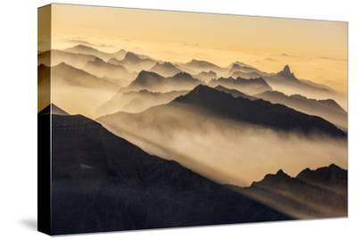 Smoke from Wildfires Shroud the Peaks of the Northern Rockies-Keith Ladzinski-Stretched Canvas Print