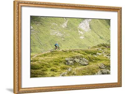 Mountain Biker In The Swiss Alps-Axel Brunst-Framed Photographic Print