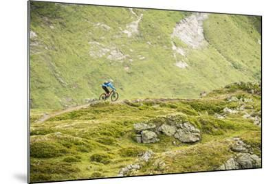 Mountain Biker In The Swiss Alps-Axel Brunst-Mounted Photographic Print