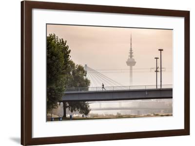 Mannheim, Baden-Württemberg, GER: Male Running Over Bridge Crossing River Neckar On Foggy Morning-Axel Brunst-Framed Photographic Print