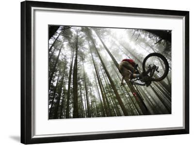 Mountain Biker Catches Air In The Mist Of The Northwest Rainforest Near Bellingham, WA-Jay Goodrich-Framed Photographic Print