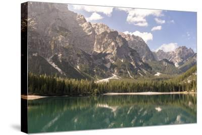 Lake Prags, Prags Dolomites, South Tyrol, Italy: The Mountains And Trees Refelcting On The Lake-Axel Brunst-Stretched Canvas Print