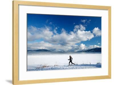 Noelle Zmuda Goes For Winter Run On The Pond Oreille Bay Trail, Sandpoint, Idaho. Lake Pend Oreille-Ben Herndon-Framed Photographic Print