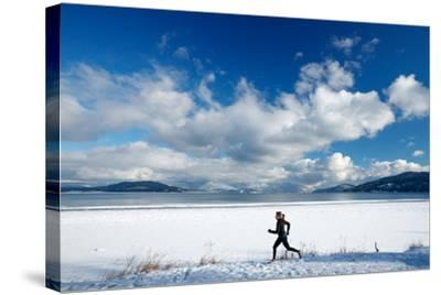 Noelle Zmuda Goes For Winter Run On The Pond Oreille Bay Trail, Sandpoint, Idaho. Lake Pend Oreille-Ben Herndon-Stretched Canvas Print