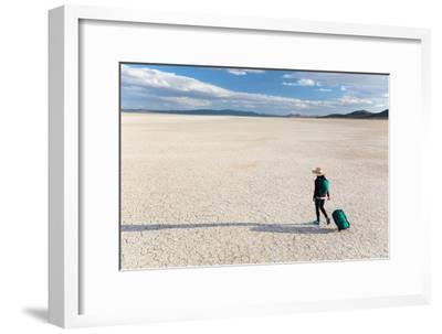 Traveler Rolls A Carry-On Suitcase, The Playa In The Alvord Desert Of SE Oregon-Ben Herndon-Framed Photographic Print