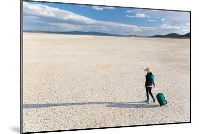 Traveler Rolls A Carry-On Suitcase, The Playa In The Alvord Desert Of SE Oregon-Ben Herndon-Mounted Photographic Print