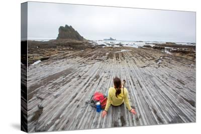 Bekah Herndon Sits On Rock Formations During Hike On Rialto Beach In The Olympic NP In Washington-Ben Herndon-Stretched Canvas Print