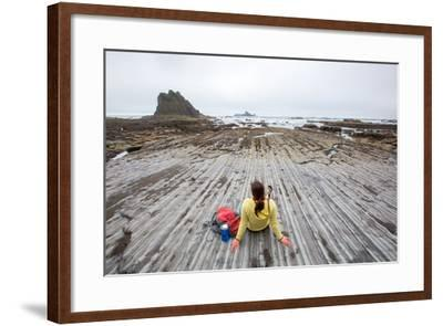 Bekah Herndon Sits On Rock Formations During Hike On Rialto Beach In The Olympic NP In Washington-Ben Herndon-Framed Photographic Print