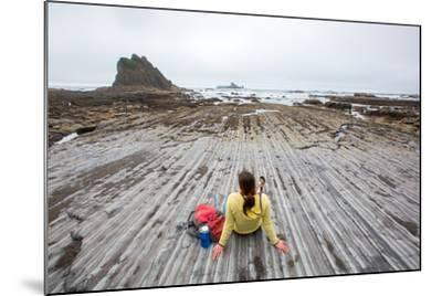 Bekah Herndon Sits On Rock Formations During Hike On Rialto Beach In The Olympic NP In Washington-Ben Herndon-Mounted Photographic Print