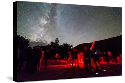 A Star Party Taking Place Below A Brilliant Night Sky, Capitol Reef National Park, Utah-Mike Cavaroc-Stretched Canvas Print