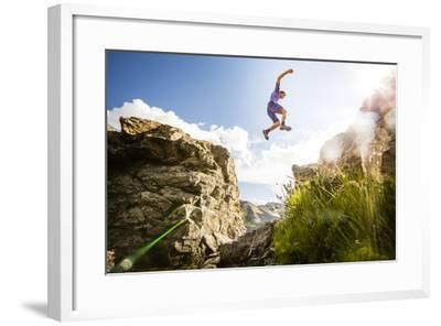 Ben Rueck Catches Some Air During A High Mountain Trail Run Just Outside Marble, CO-Dan Holz-Framed Photographic Print