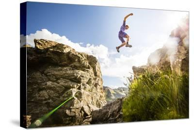 Ben Rueck Catches Some Air During A High Mountain Trail Run Just Outside Marble, CO-Dan Holz-Stretched Canvas Print