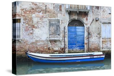 Boat And Blue Door. Venice. Venezia Province. Veneto. Italy-Oscar Dominguez-Stretched Canvas Print