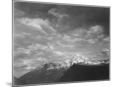 "Dark Foreground And Clouds Mountains Highlighted ""Heaven's Peak"" Glacier NP Montana. 1933-1942-Ansel Adams-Mounted Art Print"