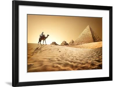 Bedouin on Camel near Pyramids in Desert- Givaga-Framed Photographic Print
