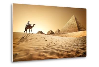 Bedouin on Camel near Pyramids in Desert- Givaga-Metal Print