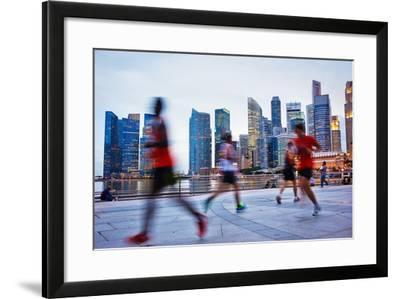 People Runing in the Evening in Singapore-joyfull-Framed Photographic Print