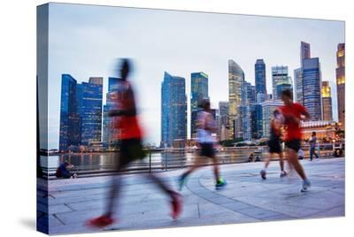 People Runing in the Evening in Singapore-joyfull-Stretched Canvas Print