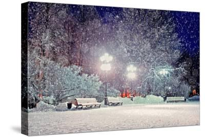Winter Night Landscape - Evening in the Night Snowy Park with Benches under Snowfall-Marina Zezelina-Stretched Canvas Print