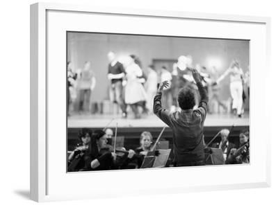 Orchestra Conductor Leading the Musicians in the Theater-Anna Jurkovska-Framed Photographic Print