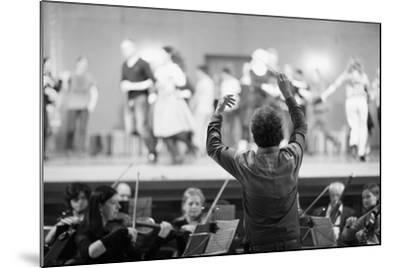 Orchestra Conductor Leading the Musicians in the Theater-Anna Jurkovska-Mounted Photographic Print
