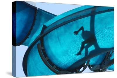 Kid Sliding a Blue Waterslide- DWaschnig-Stretched Canvas Print