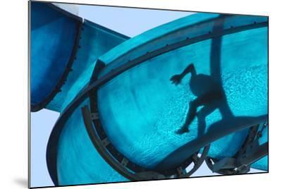 Kid Sliding a Blue Waterslide- DWaschnig-Mounted Photographic Print