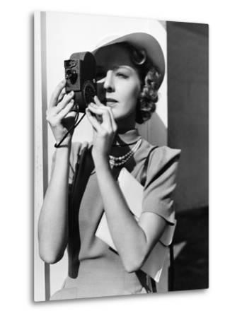 Portrait of a Young Woman Taking a Picture with a Camera-Everett Collection-Metal Print