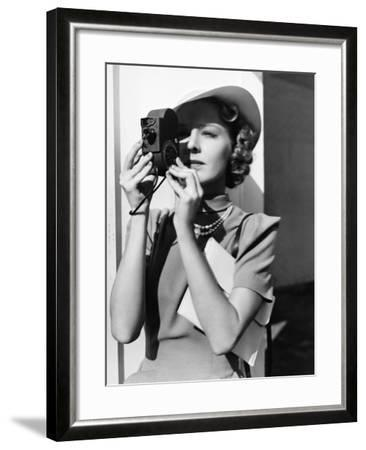 Portrait of a Young Woman Taking a Picture with a Camera-Everett Collection-Framed Photographic Print