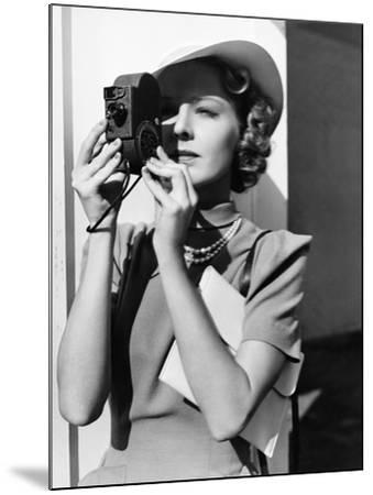 Portrait of a Young Woman Taking a Picture with a Camera-Everett Collection-Mounted Photographic Print